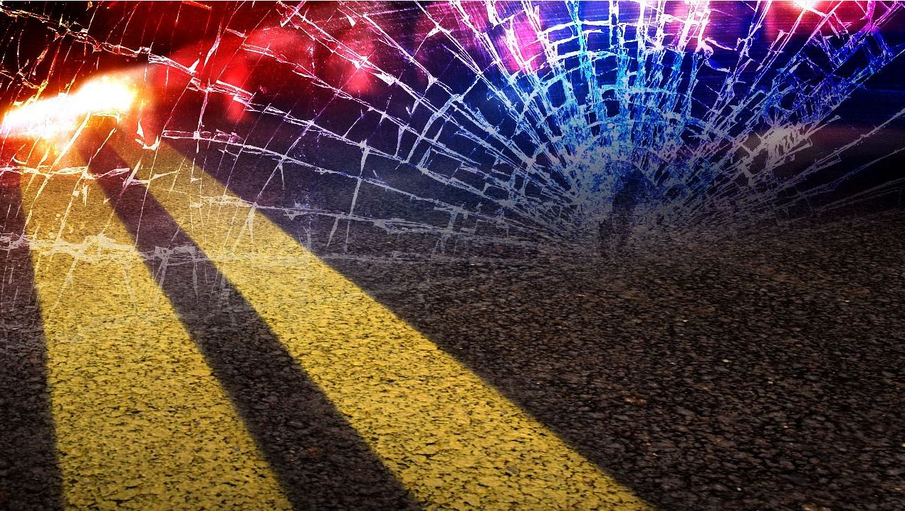 A accident graphic with a broken windshield overlaying double yellow line asphalt with emergency lights in the background.