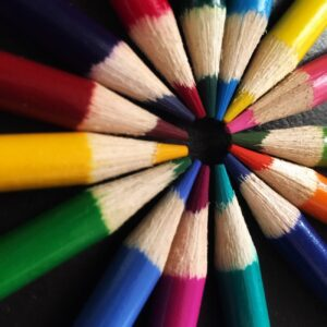 colored pencils come to a colorful circle at their points