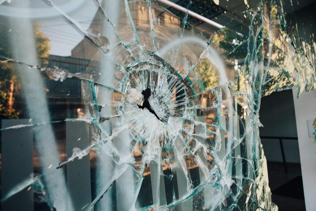 broken window, looted store, looting, protest damage, business damaged in protest, business damaged by looting,