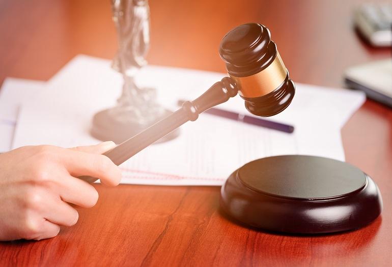 Woman holding judge gavel