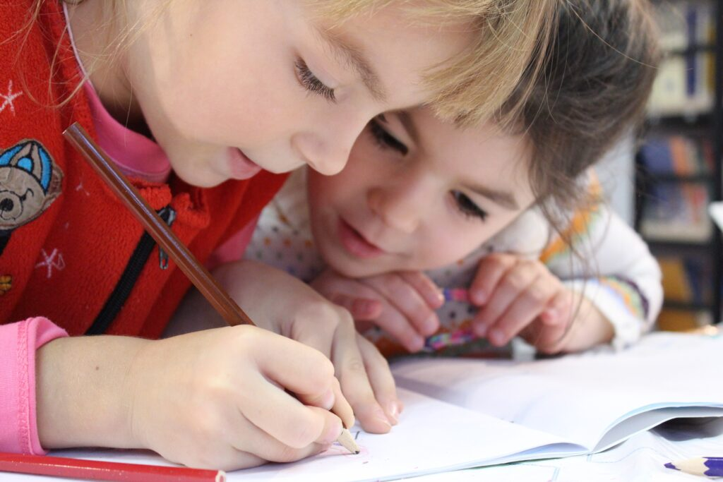 daycare, child care, childcare, day care center, girls reading, girls studying, school