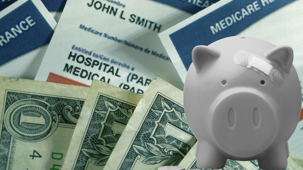A pale, ounded piggy bank with a bandaid over its eye sits before a backdrop of a pile of dollar bills and Medicare cards.