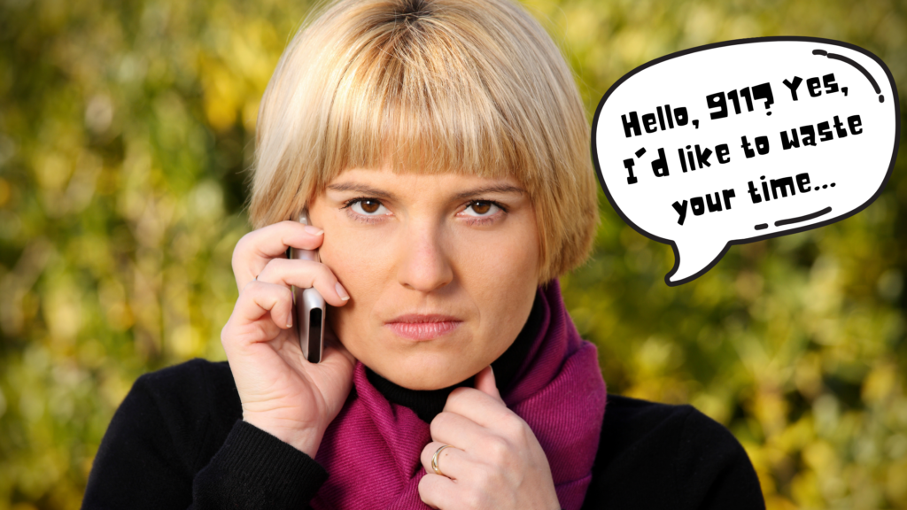 """A white female with short blonde hair clutches her pink scarf while holding a phone to her ear with a scowl on her face. A speech bubble next to her head says """"Hello, 911? Yes I'd like to waste your time..."""""""