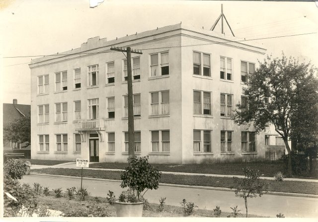 A historic photo of a square building, the Taylor-Lacey Hospital circa 1921