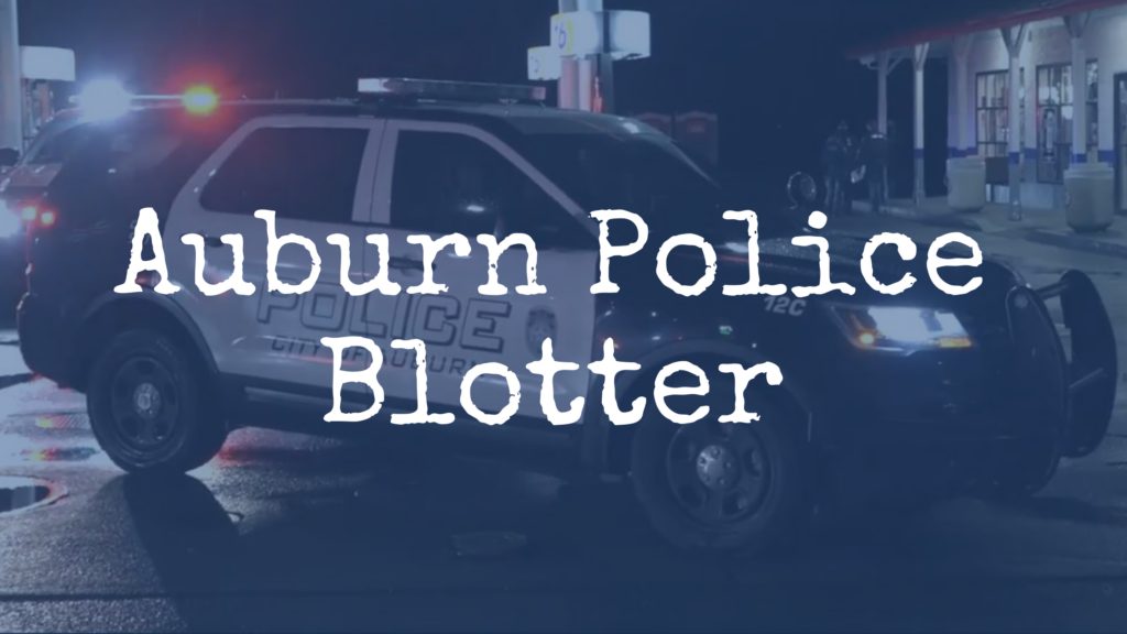 """a photo of an APD SUV at night at a crime scene at a gas station """"Auburn Police Blotter"""" is written over the photo"""