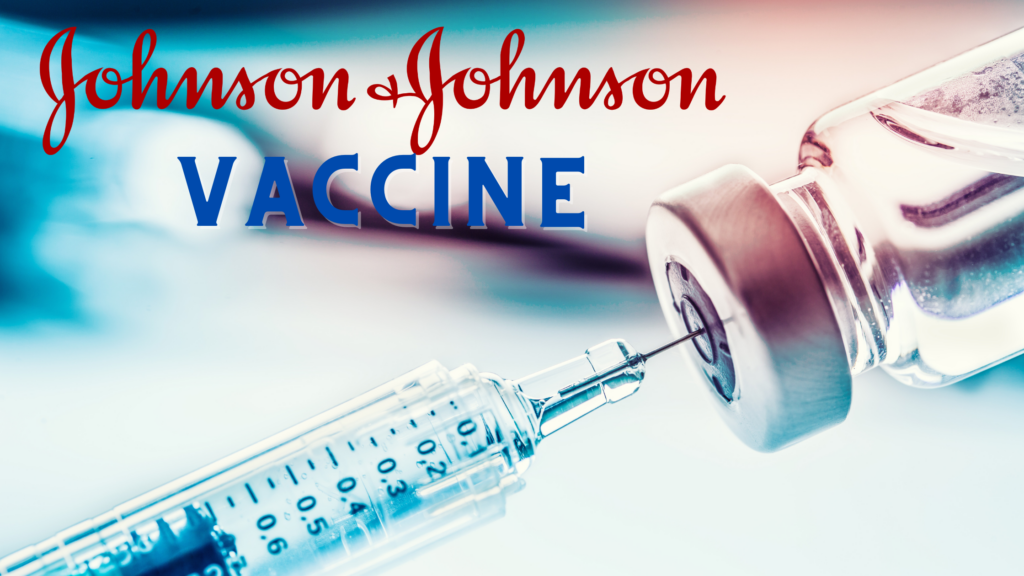 """A needle pulls from a small vaccine bottle. """"Johnson & Johnson Vaccine"""" is written on the blue toned photo"""