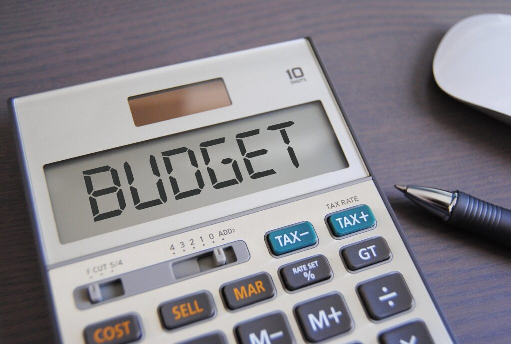 the word BUDGET is digitally written on a calculator