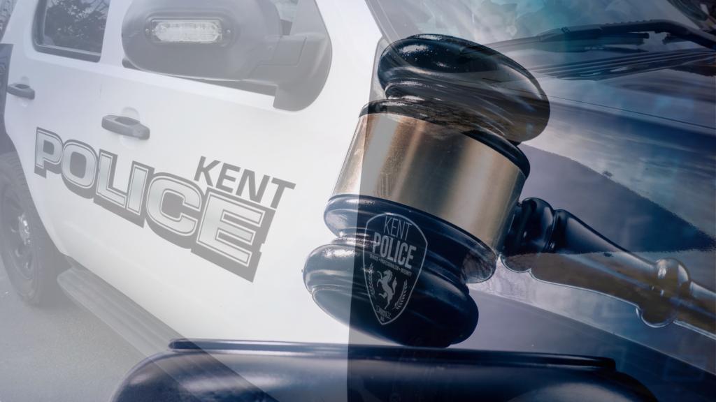 a judge's gavel overlaid a KPD SUV