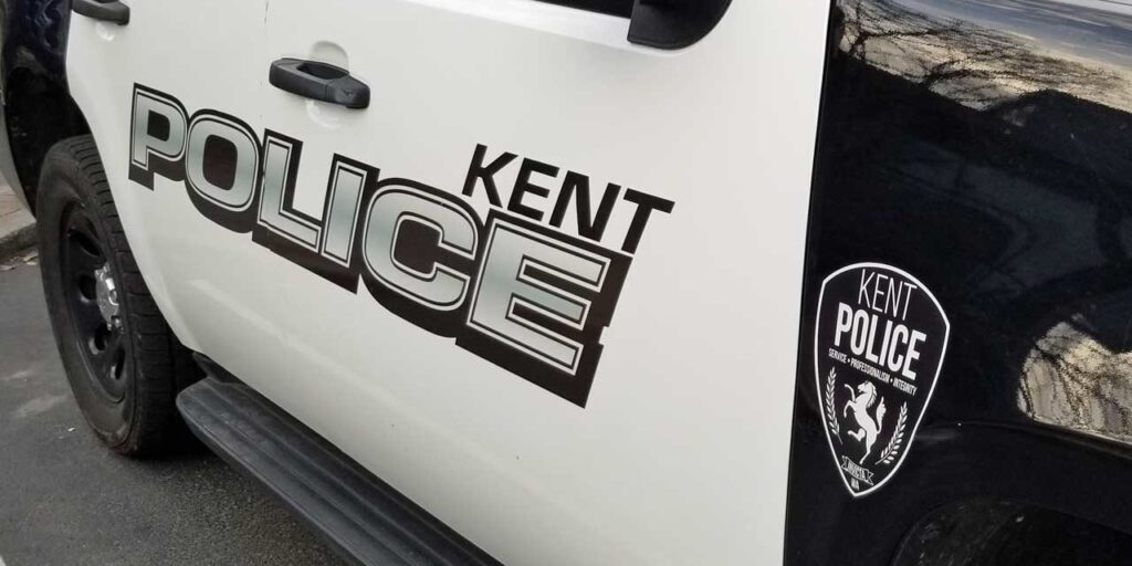 The door of a kent police SUV showing the Kent Police logo