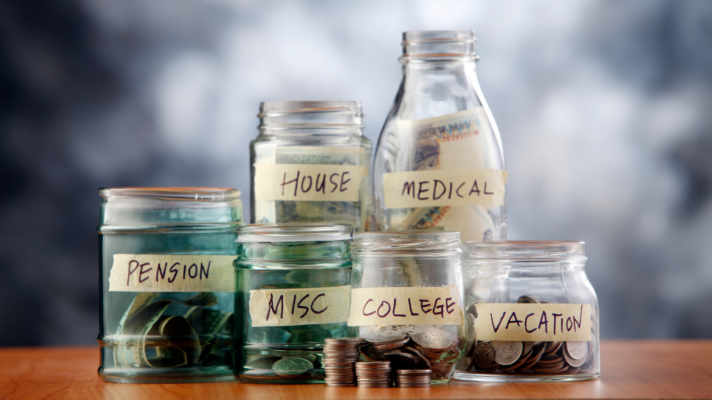 Jars with money in them are labeled with things like Health, Investments, Education