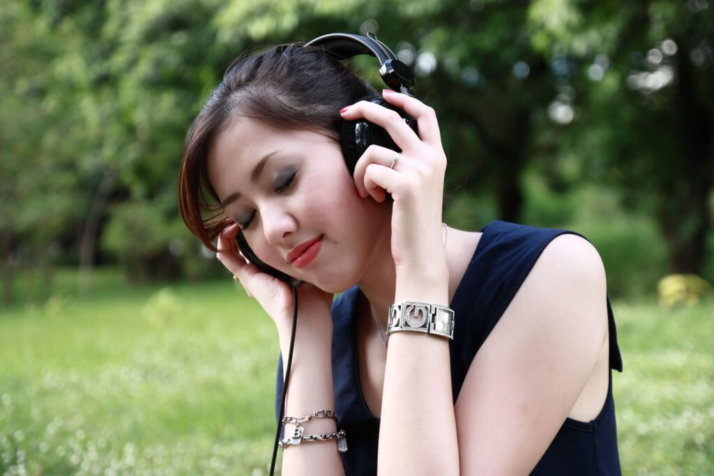 a female listens to music outside