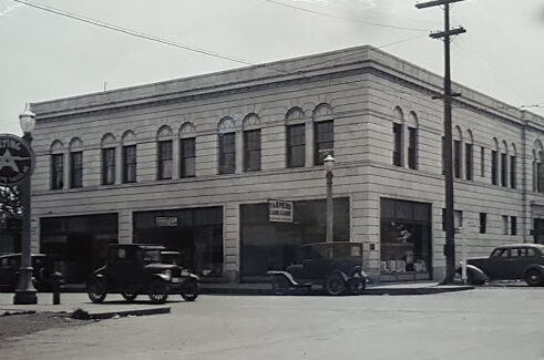 1930s Street Scene, showing the Masonic Temple and signage for Farmer's Cash and Carry Store and Blanche's Beauty Shop.