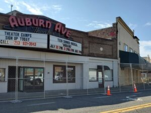 The from of the Auburn Avenue Theater with a temporary chain link fence around it due to the recent MAx House Fire