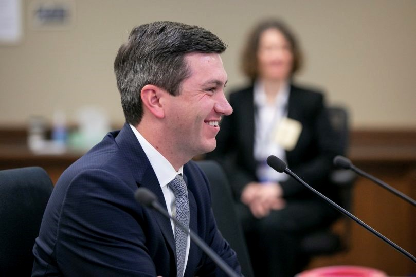 auburn representative Drew Stokesbary on the statehouse floor