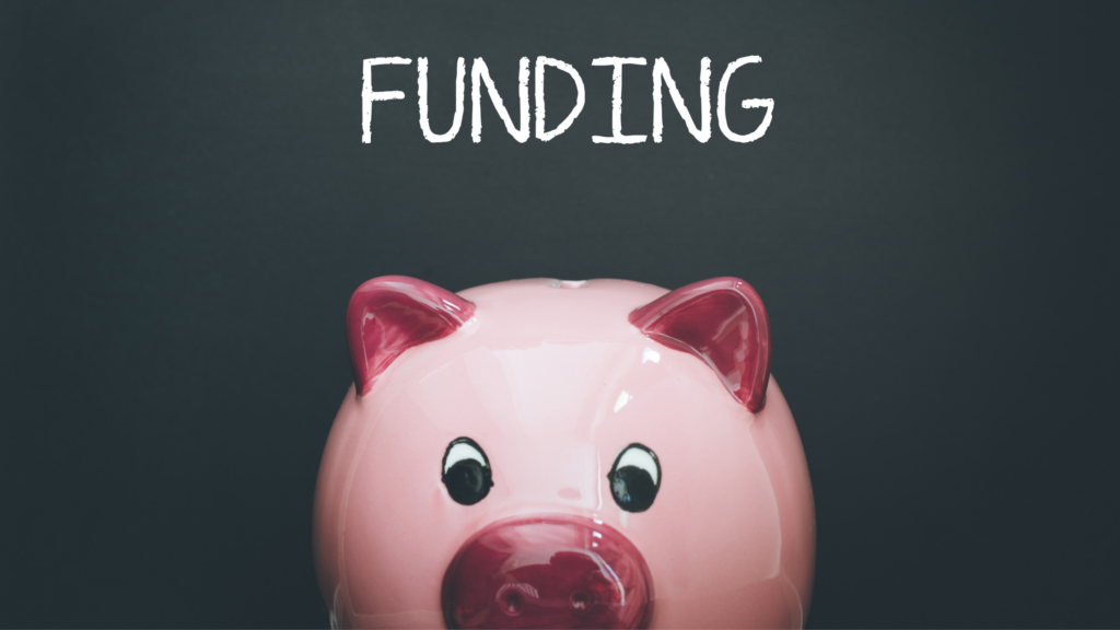 A shiny pink piggy bank peeks up from the bottom of the photo, the word FUNDING written above it