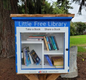 a close up of the DAR little library in Indian Tom park