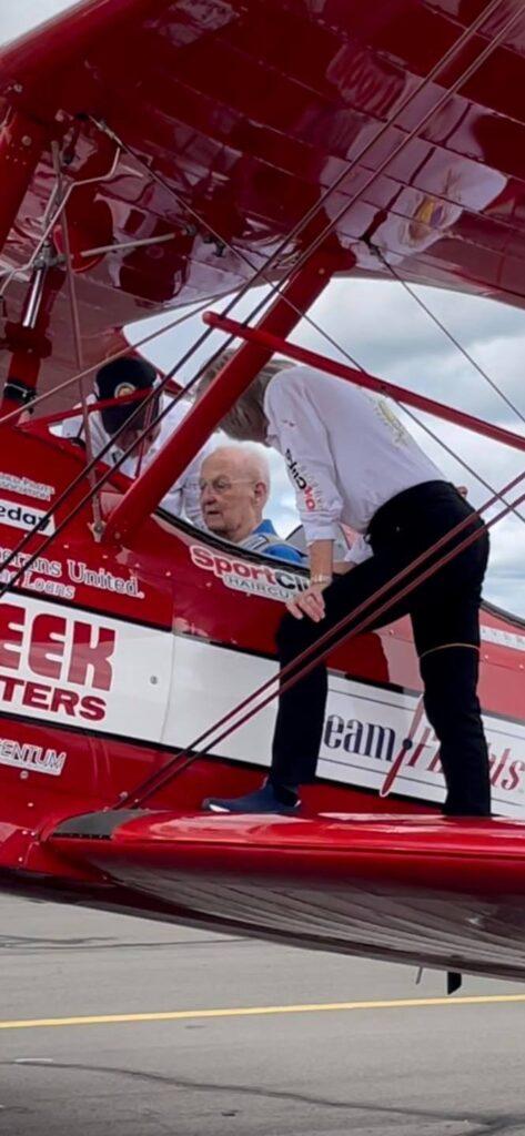 Prestige living resident Roy Climber in a restored biplane