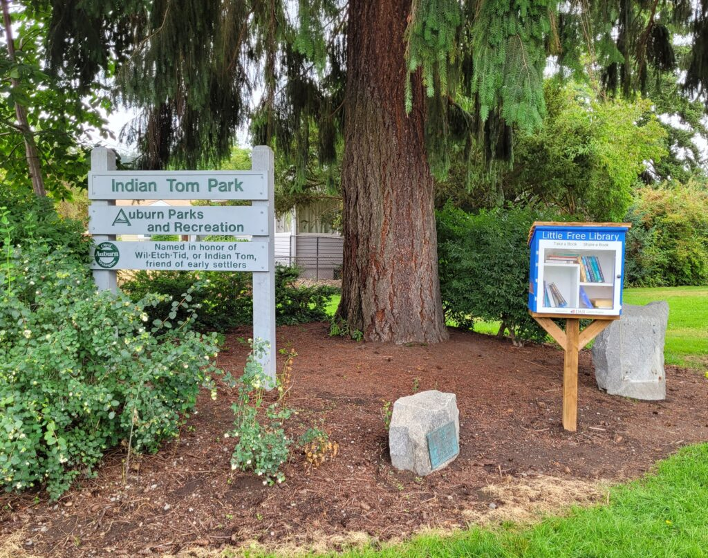 a little library near the Indian Tom Park sign