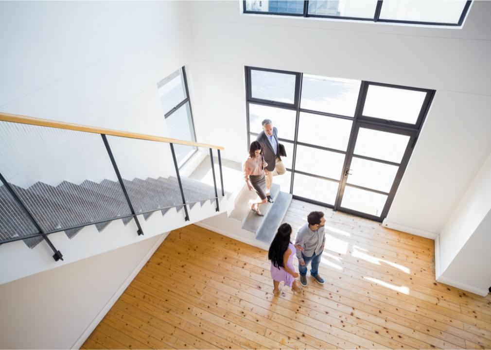A realtor shows a couple a new home