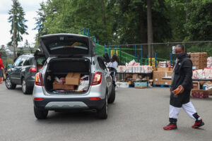 Cars line up to receive food boxes